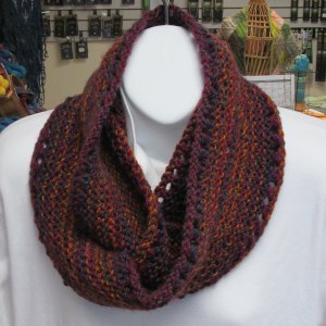 Marbius handknit cowl worn looped twice around the model's neck